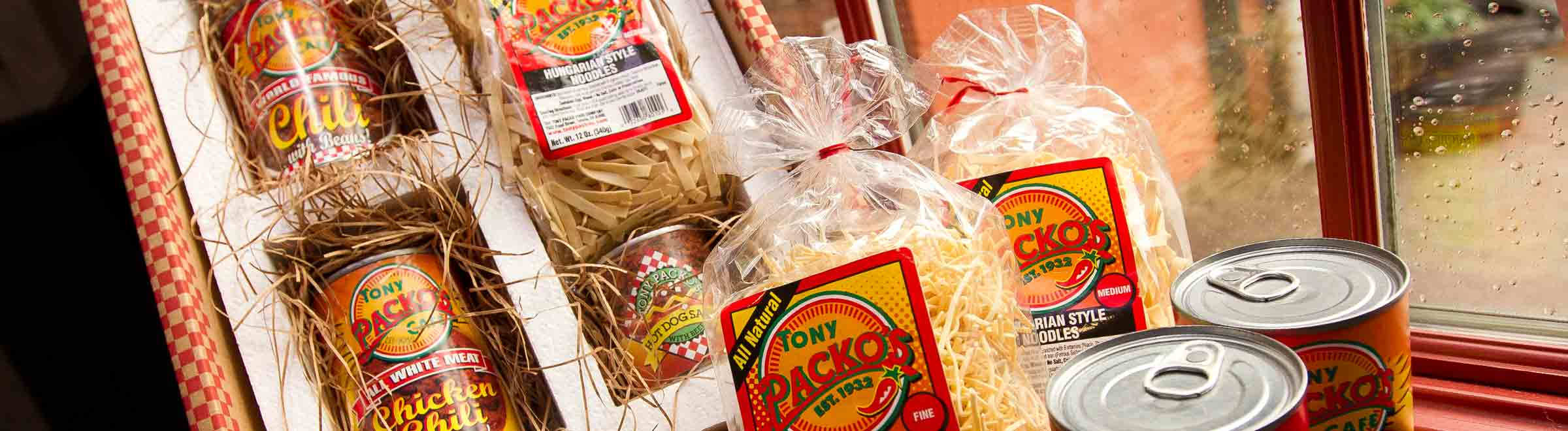 Tony Packo's Gift Pack open box with cans of hot dog chili sauce, chili, pickles & noodles