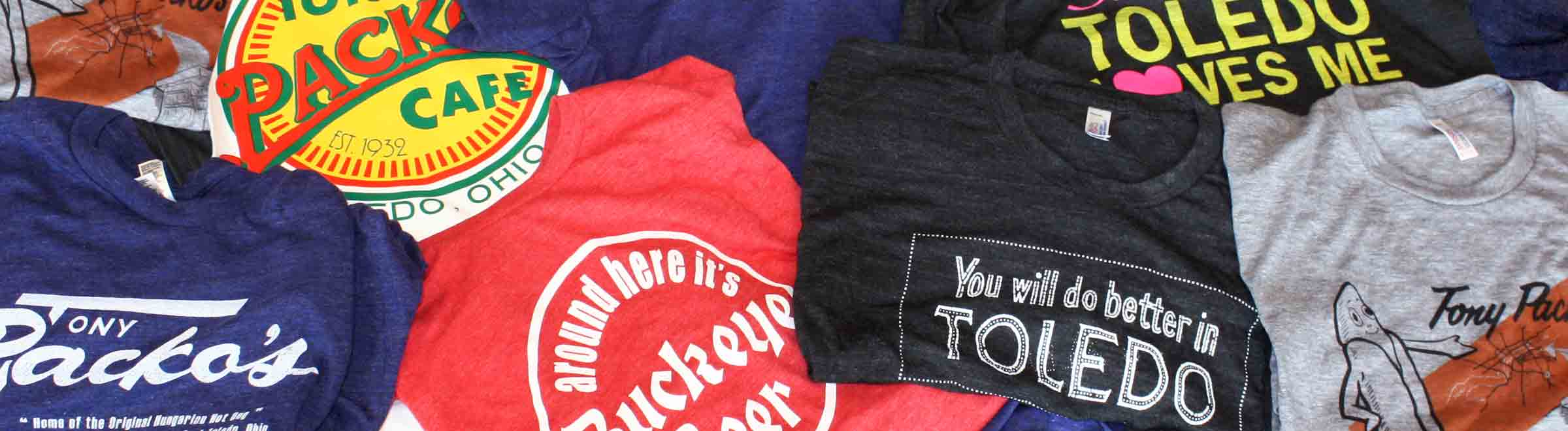 Black Somebody in Toledo Love Me, Dark Blue Tony Packos & Dark Blue TOLEDO t-shirt close-ups